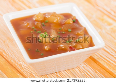 ... sweet and sour sauce with pineapple and red bell peppers. - stock
