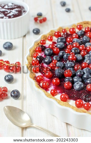 Sweet tart cake with berry fruits.Selective focus on the front berries  - stock photo