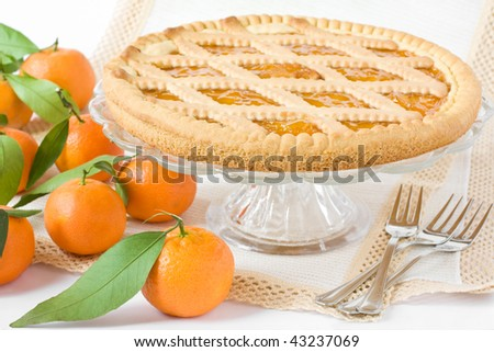Sweet tart with citrus marmelade on the table - stock photo