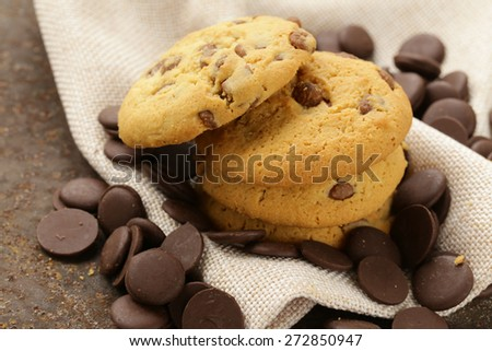 sweet tasty cookies with chocolate chips on the table - stock photo