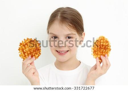 Sweet teen girl holding waffles - stock photo