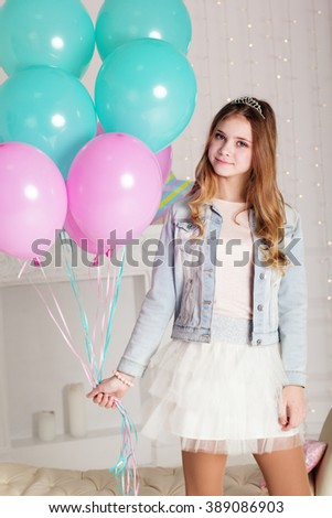 Sweet teenager girl with blue and pink balloons - stock photo