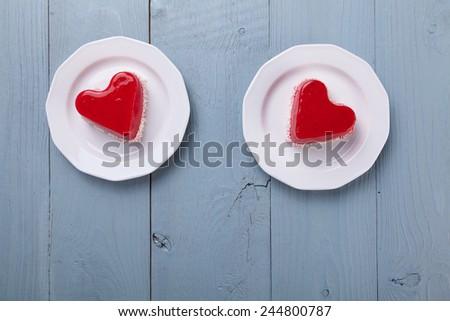 Sweet Valentine's cake - blue woodboard - stock photo