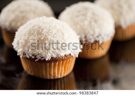 Sweet white cupcake with coconut and lemon - stock photo