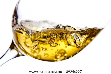 sweet wine being poured into a wineglass, isolated  on white background - stock photo