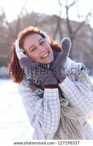Sweet winter girl in the park outdoors - stock photo