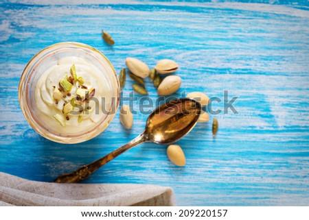Sweet Yogurt with Saffron and Pistachios Indian Dish Shrikhand - stock photo