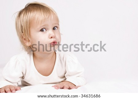 Sweet young blond girl - space for text - stock photo