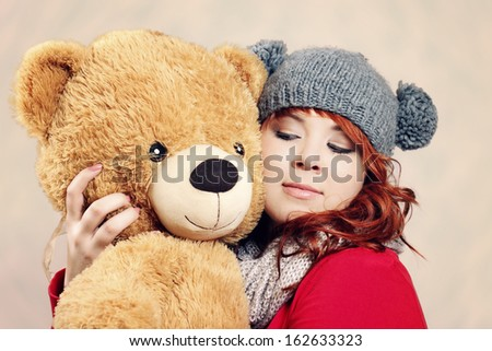 Sweet young woman dreaming with her teddy bear - stock photo