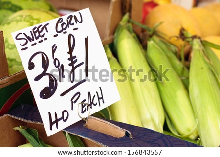 Sweetcorn for sale on a greengrocer stall at a market - stock photo