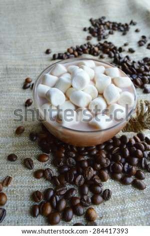 sweets, candy, coffee beans, sweets.hot cocoa with marshmallows,milk, and chocolate,cinnamon sticks,chocolate - stock photo