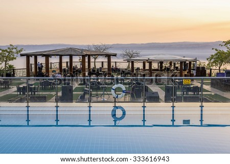 Sweimeh, Jordan - April 07, 2015: View of sunset over death sea from Horizon Terrace at Holiday Inn Resort Dead Sea. This outdoor bar and restaurant is a relaxed spot at any time of day. - stock photo