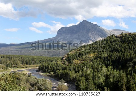 Swiftcurrent Creek feeds Lake Sherburene, a man-made lake, dam built in early 1900�s. Used as a reservoir for irrigation purposes in northern Montana. Mostly located within Glacier National Park. - stock photo