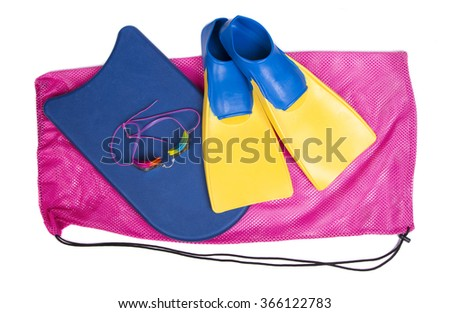 Swim fins, kick board and goggles on a pink swim bag, isolated white background for high school swim team background or competitive swim teams.  - stock photo