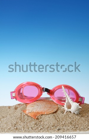 Swim goggles with Seashell. - stock photo