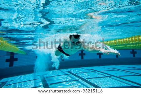 Swimmer Under Water in Pool - stock photo