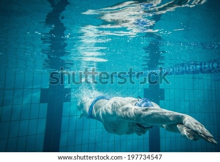 Swimmer under water in swimming pool - stock photo