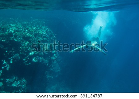 swimmer underwater after the jump - stock photo