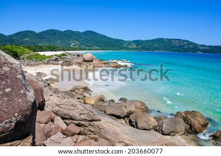 Swimming and enjoying the beach and nature of Lopes Mendes in Ilha Grande, Rio, Brazil. South America. - stock photo