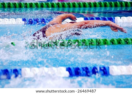 swimming, bbutterfly in waterpool with blue water - stock photo