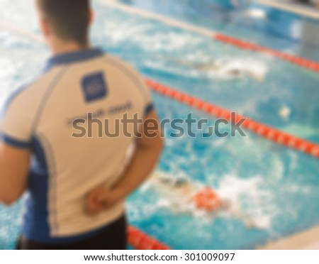 Swimming competition at fitness centre theme creative abstract blur background with bokeh effect - stock photo