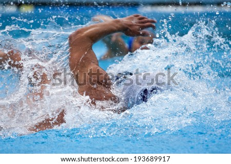 swimming in the swimming pool - stock photo