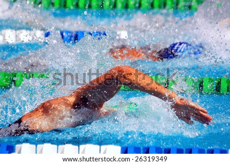 swimming in waterpool with blue water - stock photo