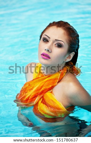 Swimming pool and hot red-haired girl - stock photo