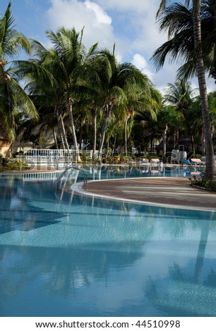 swimming pool and hotel Caribbean resort - stock photo