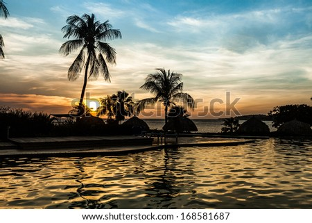 Swimming Pool and Seascape on the Caribbean  Island of Curacao - stock photo
