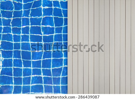 Swimming pool and wooden deck for background - stock photo