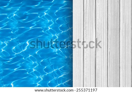 Swimming pool and wooden deck ideal for backgrounds - stock photo