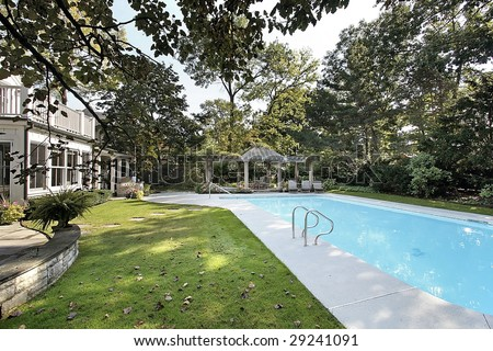 Swimming pool at luxury home - stock photo