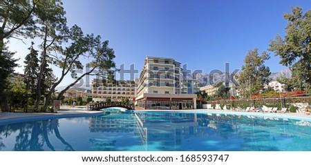 Swimming pool at Mediterranean resort hotel in Turkey - stock photo