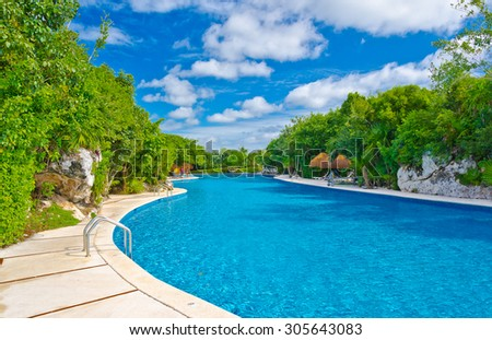 Swimming pool at the luxury mexican, caribbean resort oasis. - stock photo