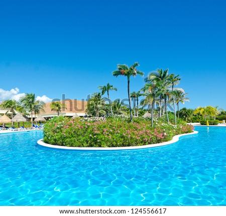 Swimming pool at the luxury mexican resort. Bahia Principe, Riviera Maya. - stock photo