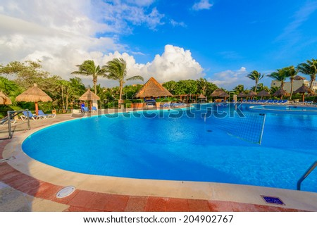 Swimming pool at the luxury mexican resort,  early morning hours. - stock photo