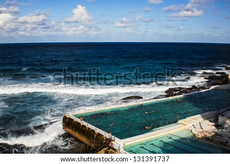 swimming pool beside the sea - stock photo