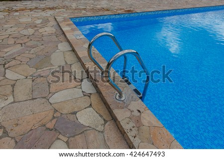 Swimming pool. Blue spa swimming pool with clean water - stock photo