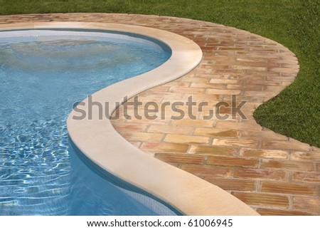 Swimming pool detail in summer time. - stock photo