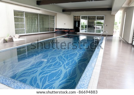 swimming pool in a luxury house - stock photo