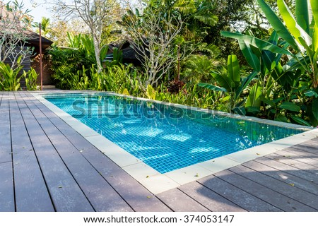 swimming pool in beautiful park - stock photo