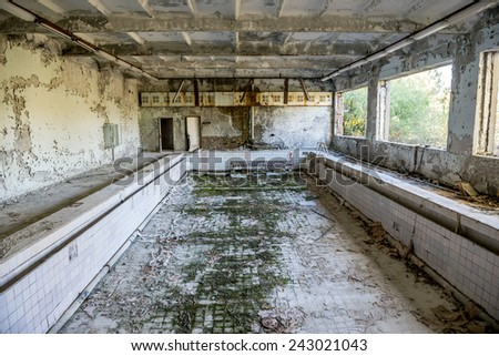 swimming pool in Energetik, the local Palace of Culture in Pripyat town, Chernobyl Nuclear Power Plant Zone of Alienation, Ukraine - stock photo