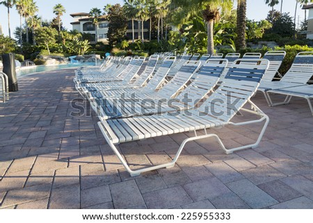 Swimming pool in spa resort, deck chairs on the beach, Orlando, Florida - stock photo