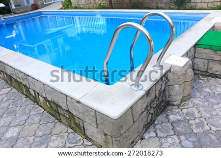 Swimming pool in the courtyard of the mini hotel close-up - stock photo