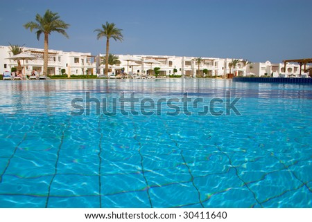 swimming pool in tropical hotel - stock photo