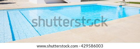 Swimming pool in tropical resort hotel pool  - stock photo
