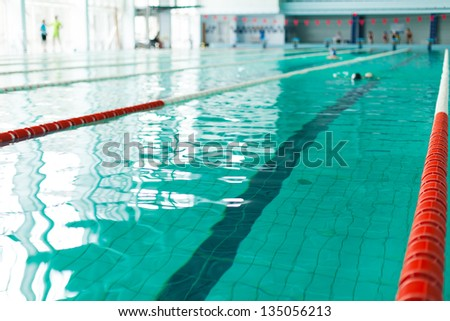 Swimming pool lanes in competition pool - stock photo