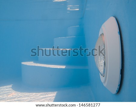 Swimming pool light and steps underwtare  - stock photo