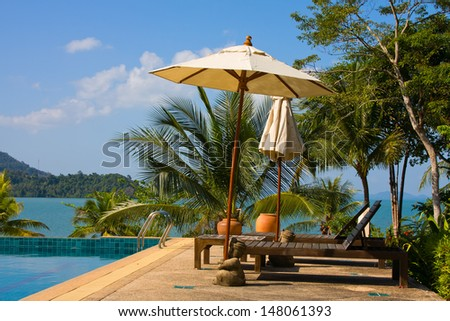 Swimming pool near the sea , Thailand. - stock photo